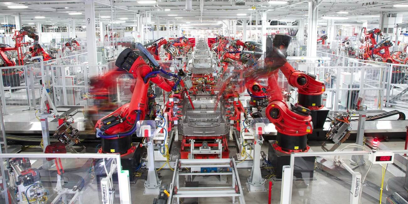 image showing a Tesla car being constructed on the factory production line